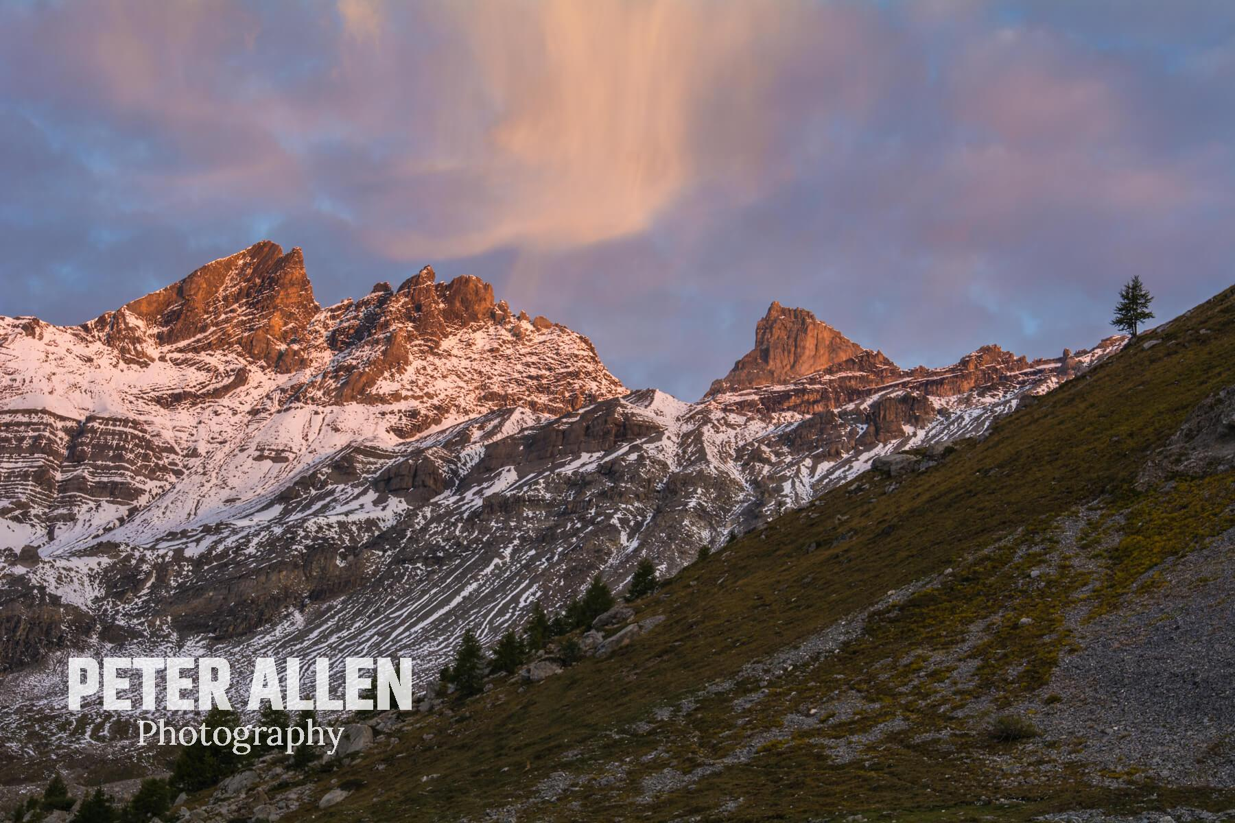 Haute Cime with first light illuminating it's beauty with a Virga in the sky.