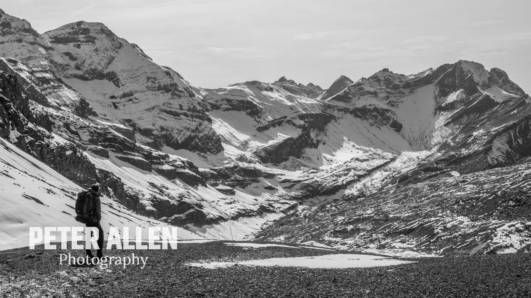 Black/white image of me looking at snow-covered swiss mountains