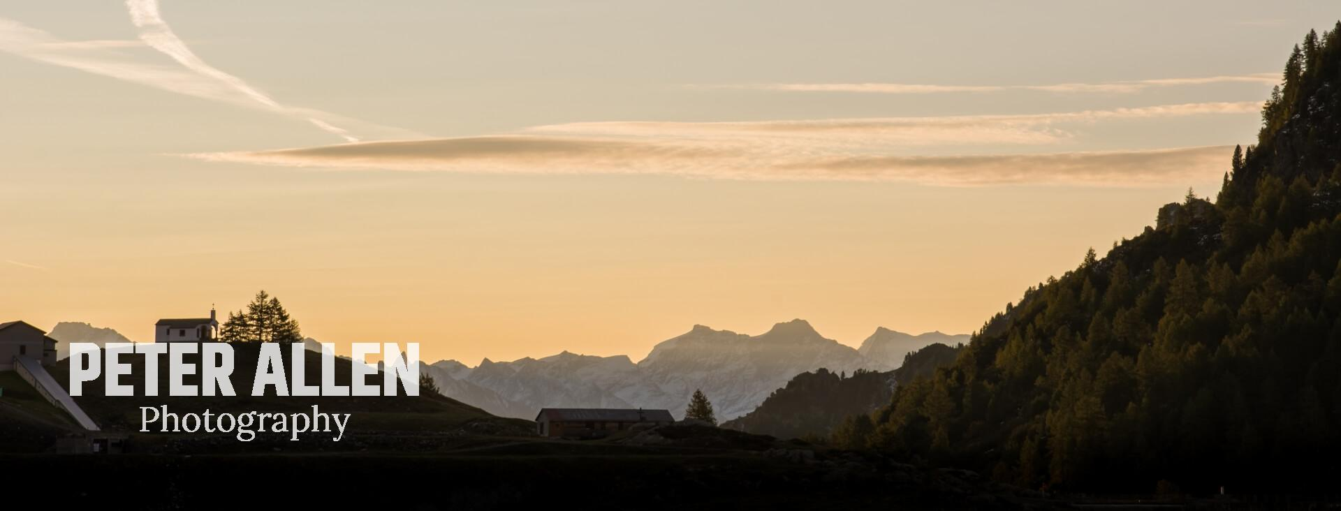 Lac de Salanfe's church silhouetted with mountains in the background, beautiful golden light